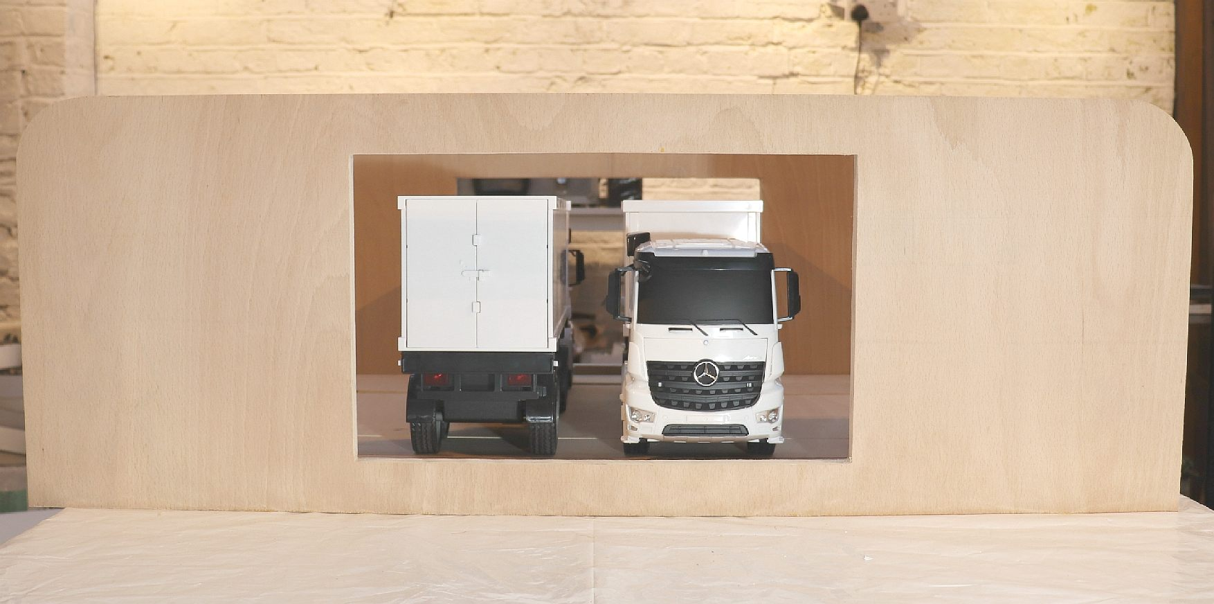 1:20th scale model of an electric truck service station using instant cartridge refuelling